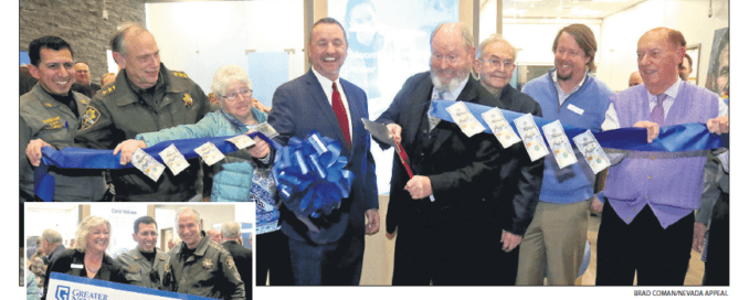 Newspaper clipping of ribbon cutting at GNCU Carson City